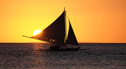 Sailing boat on the sea at the sunset at Boracay island Philippi