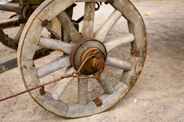 Closeup view of an vintage wooden cart-wheel. The cart was prese