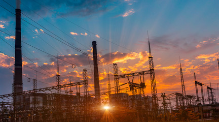 silhouette of coal electric power plant on the background of a beautiful sunset.
