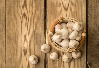 garlic in a basket on a wooden table