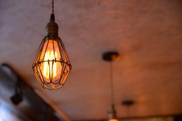 A light bulb hanging in the nightclub