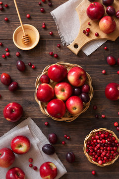 Red apples with plums and cranberries