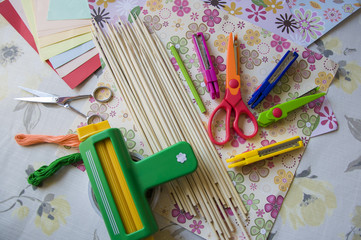 hand made scrap-booking post card and tools lying on a table