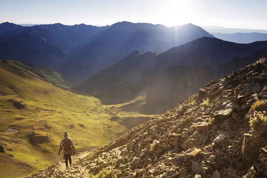 Rear view of woman walking on mountains against  sky