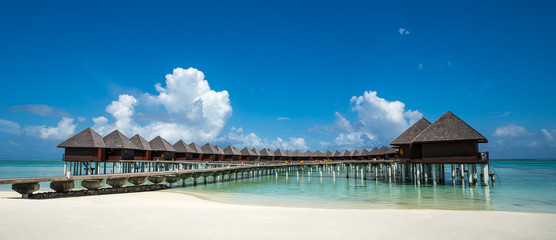 Beautiful beach with water bungalows at Maldives, panorama forma