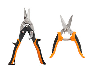 Opened pliers and nippers on the white background