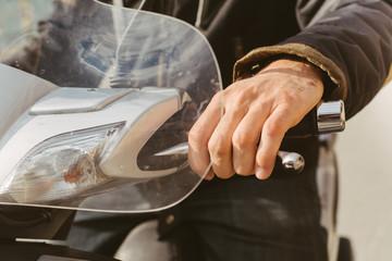 Man's hand holding steering wheel