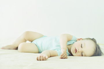Close-up portrait of a beautiful sleeping baby. Cute infant kid. Child portrait in pastel tones. The beautiful baby could be a boy or girl