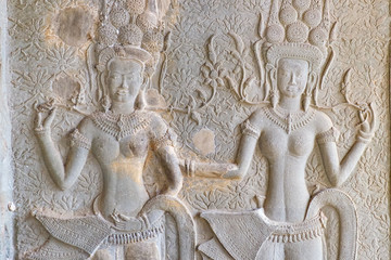 Dancing Apsaras an old Khmer art carvings on the wall in Angkor Wat temple near Siem Reap town, Cambodia