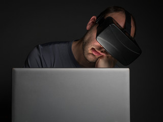 Tired addicted man to technology  using virtual reality headset
