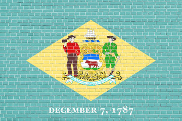 Flag of Delaware on brick wall texture background
