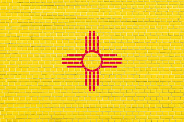 Flag of New Mexico, brick wall texture background