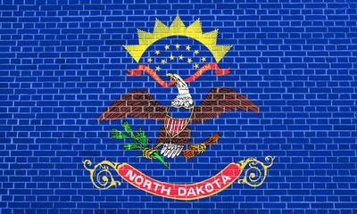 Flag of North Dakota brick wall texture background