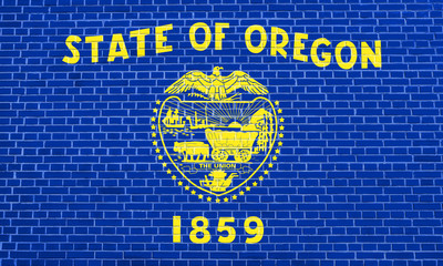 Flag of Oregon on brick wall texture background