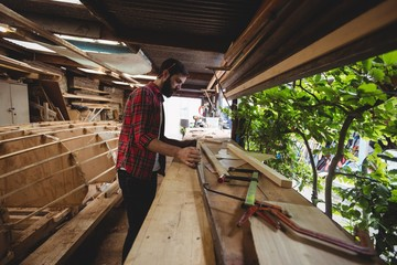 Man working on wooden plank
