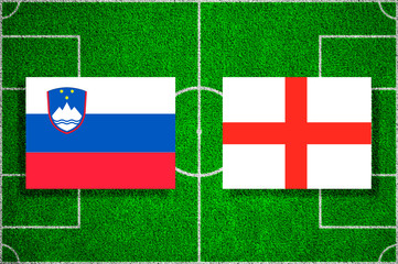 Flags Slovenia - England on the football field. 2018 football qualifiers
