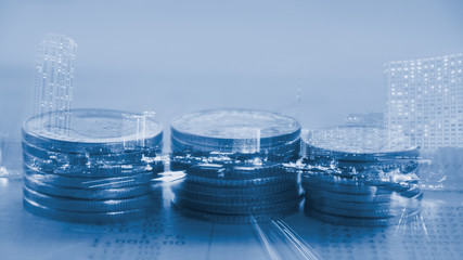 Double exposure city and rows of coins on bank statement, finance and banking concept