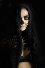 woman in day of the dead mask skull face art. Halloween face art