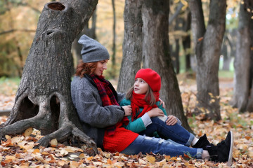 woman and daughter autumn outdoor
