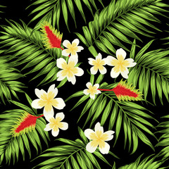 Tropical seamless pattern with palm leaves and exotic flowers. Green, white, yellow and red on black background.