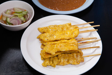 Pork satay,Grilled pork with peanut sweet sauce and sour sauce o