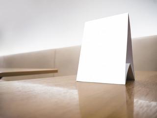 Mock up Menu frame Sign on Table Counter background