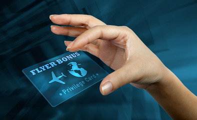 a woman's hand holding  a digital card with the word flyer bonus