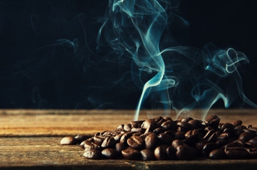 Smoke rising over roasted coffee beans