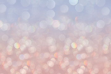 Bokeh soft pastel serenity background with blurred rainbow  lights. Festive background.