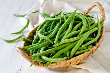 Green beans in a wicker basket
