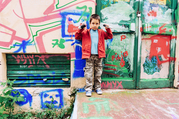 Kid painting graffiti