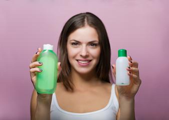 Pretty woman choosing a skin care product
