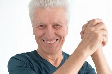 happy senior man in shirt gestures