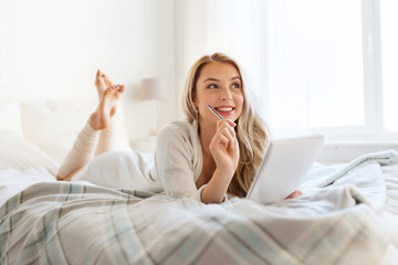 Fototapete - happy young woman with notebook in bed at home
