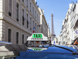 PARIS, FRANCE, on JULY 9, 2016. The Parisian taxi against the background of typical city architecture