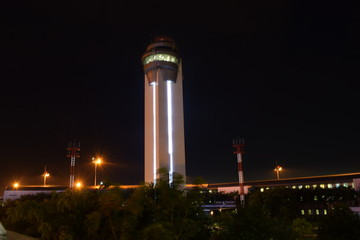 Airport control tower at night