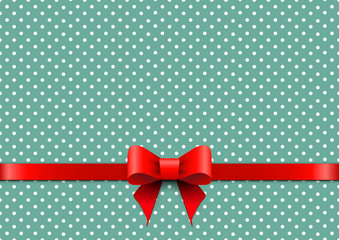 Christmas background with polka dots and red bow