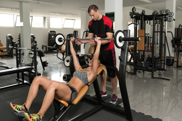 Fit Couple Together Training Chest With Weights