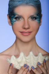 beautiful woman in the face-up mermaid