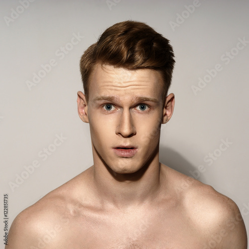 Studio Fashion Style Portrait Of Young Calm Handsome Red Hair Man Closeup Face Portrait On