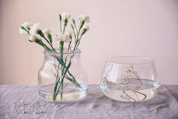 Glass vases with flowers on table