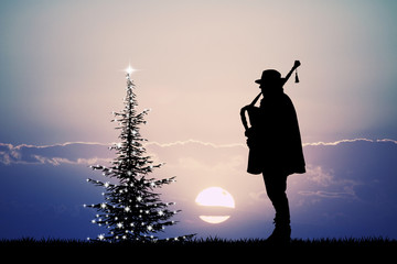 man plays the bagpipes at Christmas