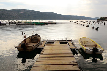 Wooden pier with fishing boats