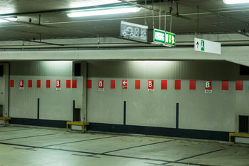 Underground car park in Cologne with sign for the exit