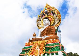 big colorful buddha statue sitting thai temple
