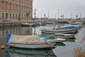 Canal grande with boats in Trieste city center