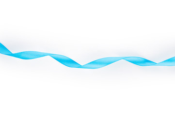 Blue satin ribbon isolated on white background. Top view. Flat lay.