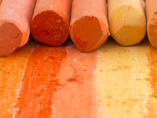 orange artistic crayons