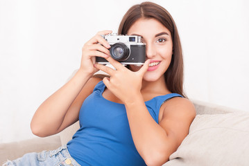 beautiful young blond woman with a camera, lifestyle