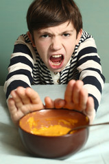boy refuse from eating smashed pumpkin soup